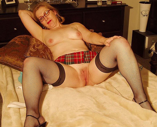 Copy of Claire plaid skirt topless spread.jpg